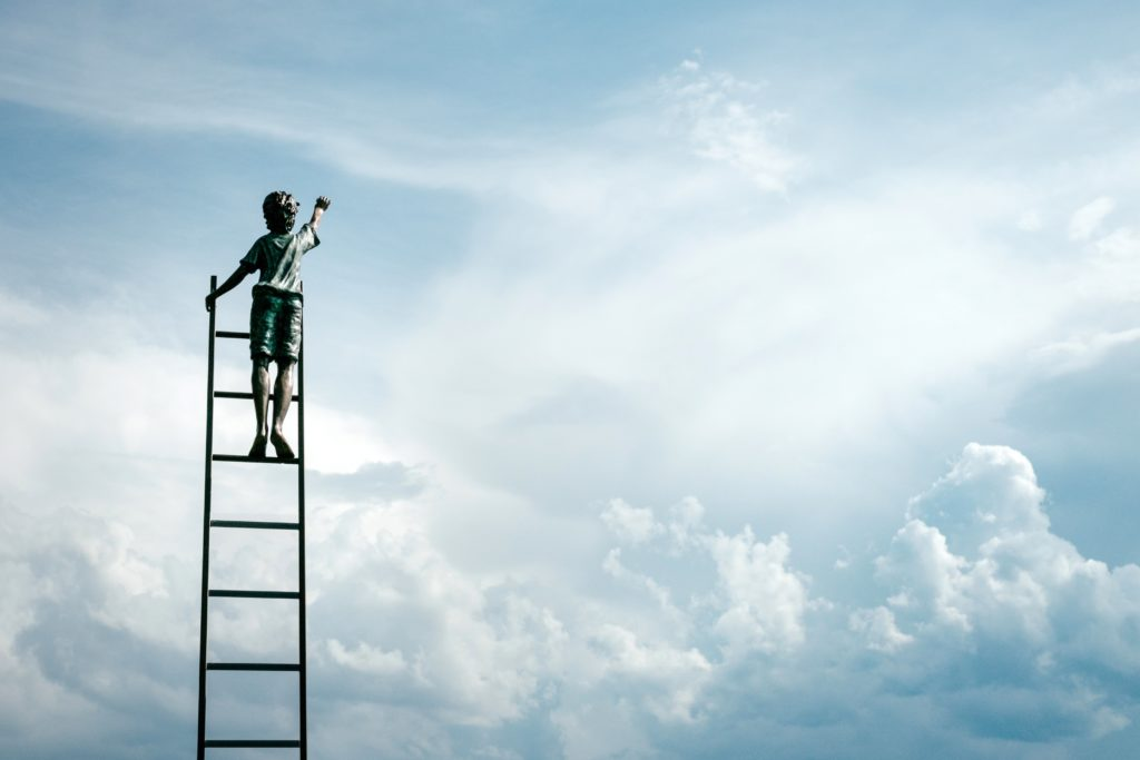 person climbs a ladder to the sky